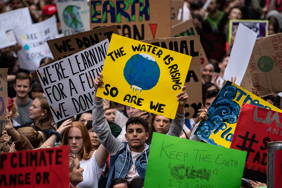 The March 15 school strike for climate drew students into the streets of cities around the world, including these students, part of a crowd of thousands in Sydney, Australia. Credit: James Gourley/Getty Images