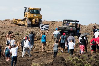 Protesters approach a Dakota Access pipeline construction site at Standing Rock in 2016. Credit: Robyn Beck/AFP/Getty Images