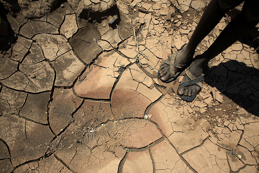 A boy stands in a dried riverbed in Kenya. Christopher Furlong/Getty Images