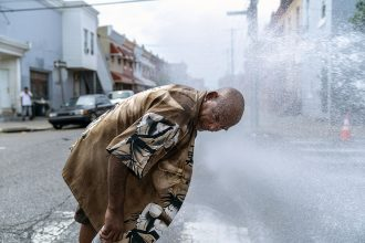 Eduardo Velev cools off in the spray of a fire hydrant in Philadelphia during a July 2018 heat wave there. Credit: Jessica Kourkounis/Getty Images