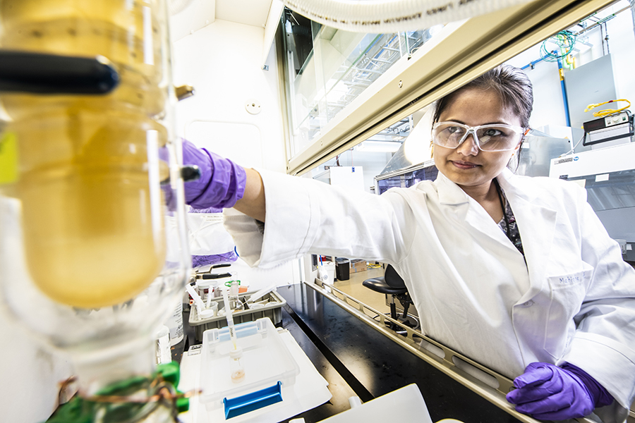 Mahisha Amarasinghe works on a new treatment to improve thin film solar technology at NREL's Science and Technology Facility, which was created to reduce the time delay in transferring technology to industry. Credit: Dennis Schroeder/NREL