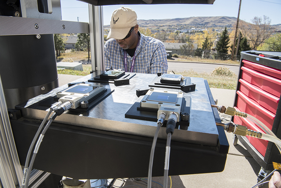 Rafell Williams, a technician at NREL, prepares to test solar cell performance at the lab's Outdoor Test Facility in Colorado. Credit: Dennis Schroeder/NREL