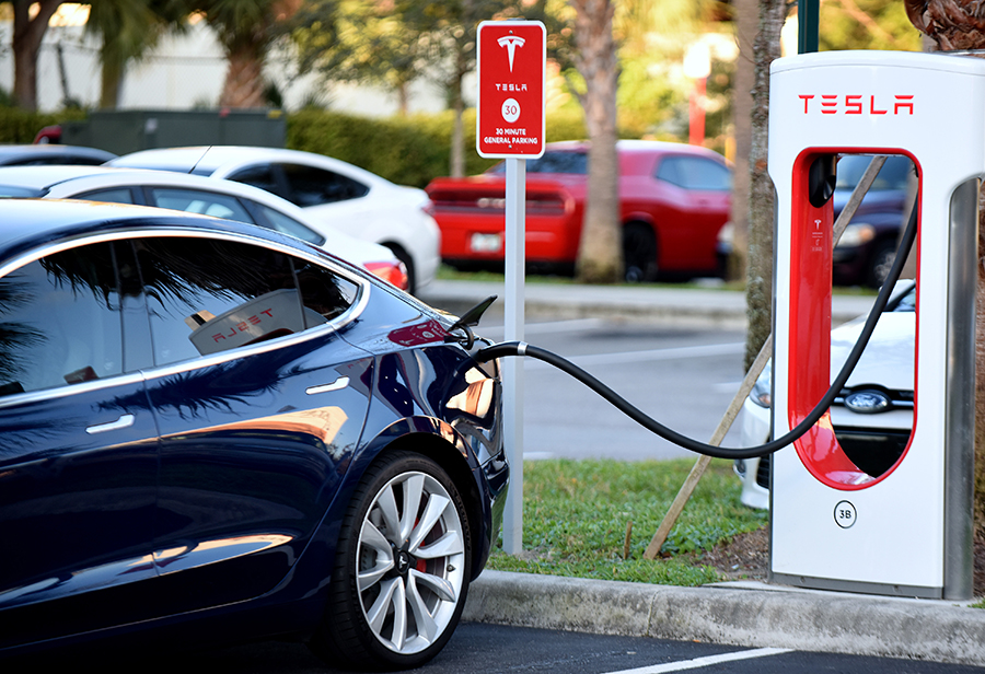 Automakers like Telsa began installing charging stations as their electric vehicle sales rose. Lack of charging infrastructure was an early impediment to sales in many areas, but that landscape is changing. Credit: Paul Hennessy/NurPhoto via Getty Images