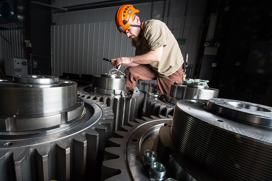 Engineer Robert Goldhor, an NREL contractor, works on the design for parts a next-generation drive train for wind turbines. Credit: Dennis Schroeder/NREL