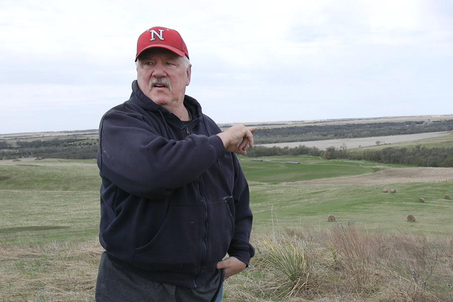 Bob Allpress shows where the Keystone XL pipeline is expected to cut through his land. Credit: Anna Belle Peevey