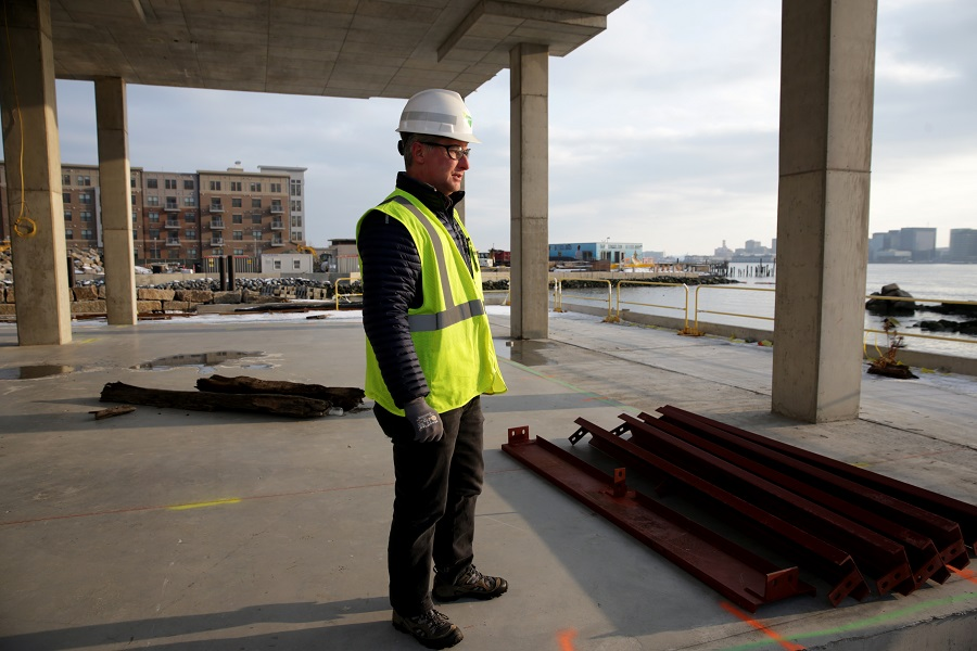 In Boston, more developments are taking sea level rise into account by building up the ground beneath buildings, installing extra-tall ground floors and redoubling other flood-protection efforts. Credit: Jonathan Wiggs/The Boston Globe via Getty Images