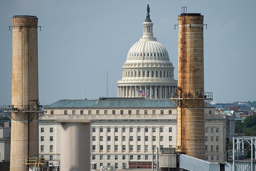 The U.S. Capitol, framed by power plant smokestacks. Credit: Saul Loeb/AFP/Getty Images