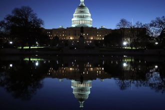 U.S. Capitol reflected. Credit: Mark Wilson/Getty Images