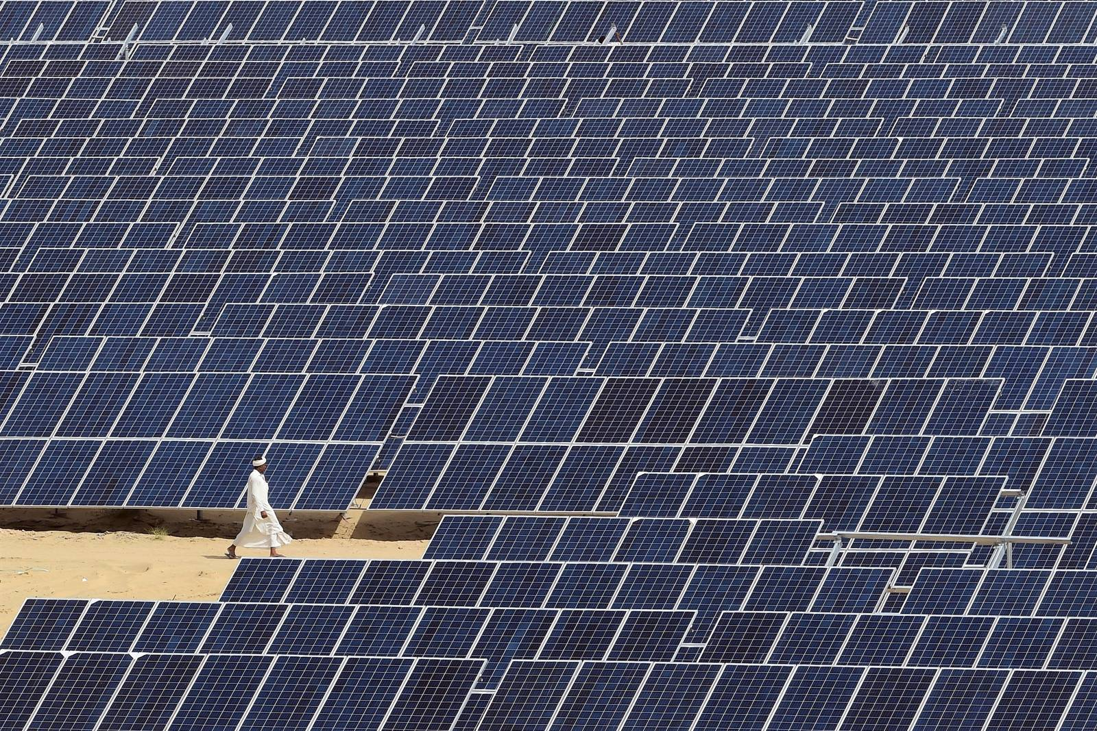 A sea of solar panels in a north Indian desert is part of the government's clean energy push. Credit: Money Sharma/AFP/Getty Images