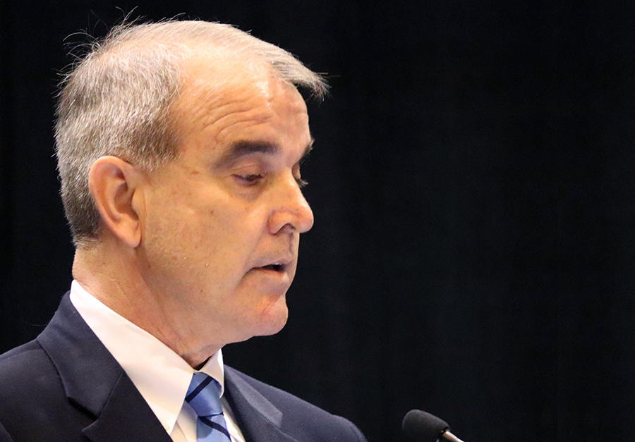 James Beamer, one of Dominion Energy's top lobbyists, told the conference about the utility's plans to cut its carbon emissions 80 percent by 2050 with plans including more offshore wind, solar power and pumped hydro storage. Credit: James Bruggers