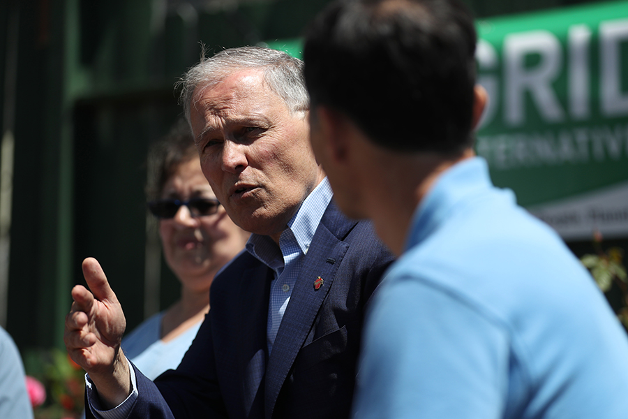 Washington Gov. Jay Inslee, who is running for U.S. president on a climate platform, met with an organization that trains solar installers. Credit: Justin Sullivan/Getty Images