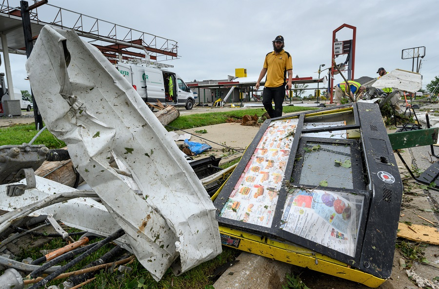 Mediacom employees look for their fiber cable among the wreckage of a Sonic Drive-In in Jefferson City, Missouri, after a tornado hit the capital city on May 23, 2019. Credit: Reed Hoffmann/Getty Images