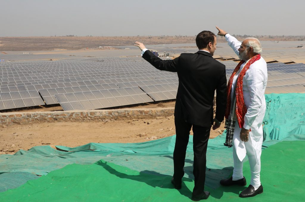 Indian Prime Minister Narendra Modi, who has supported clean energy, shows French President Emmanuel Macron a solar power plant in Uttar Pradesh state. Credit: Ludovic Marin/AFP/Getty Images