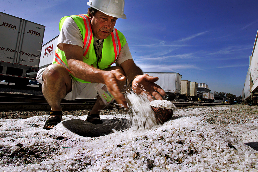 Pre-production plastic pellets, known as nurdles, that had spilled from a train car. Credit: Rick Loomis/Los Angeles Times via Getty Images
