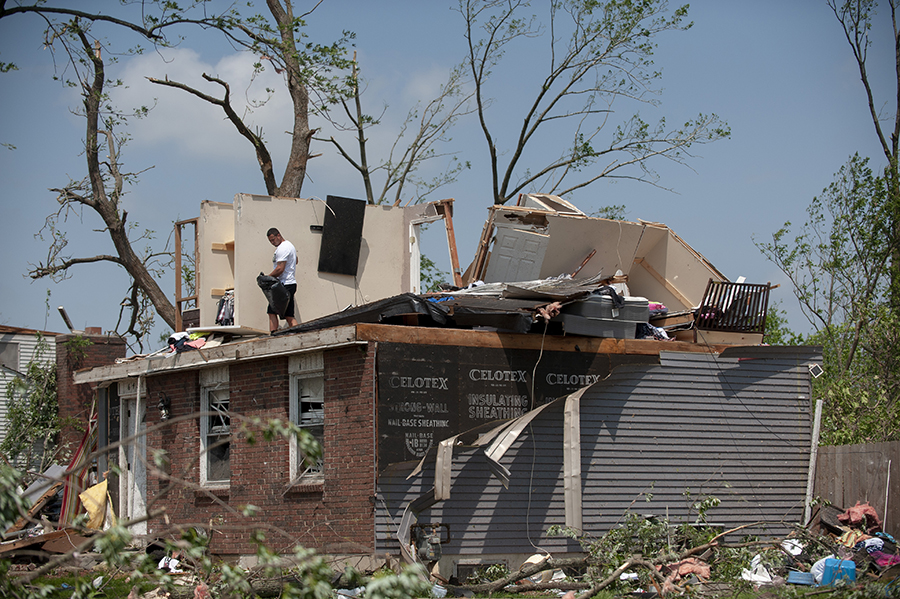 A man gathers his belongings from his damaged home in Trotwood, Ohio, on May 28, 2019, after powerful tornadoes ripped through the state. Credit: Matthew Hatcher/Getty Images
