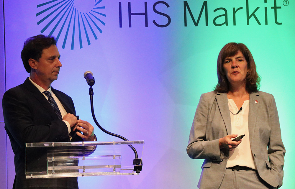 Patty Long, interim president and CEO of the Plastics Industry Association, with Nick Vafiadis, a vice president at IHS Markit. Credit: James Bruggers