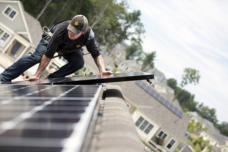 One possibility being explored in several states is to develop rates based on the value of rooftop solar power to the grid, including environmental benefits. Credit: Ben McCanna/Portland Press Herald via Getty Images