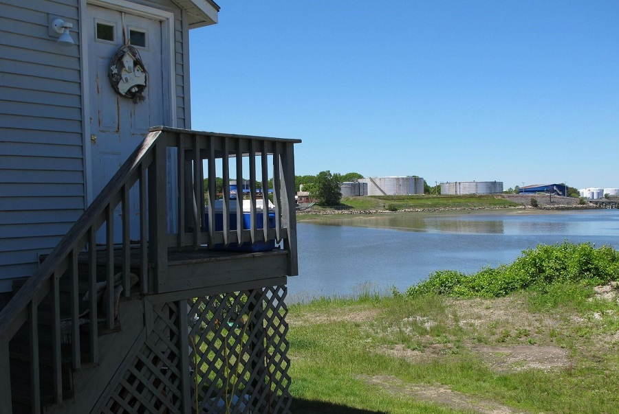 South Portland has 120 giant storage tanks, most of them for petroleum products. Many are close to schools and homes, like these tanks across the water from Barbara Saulle's home. Credit: Sabrina Shankman
