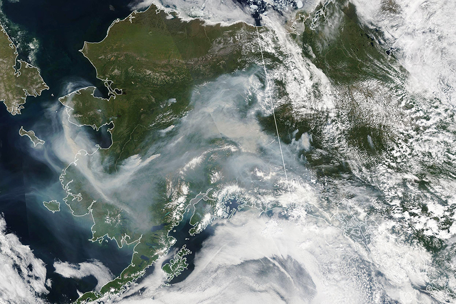 Smoke from wildfires spreads across Alaska on July 8, 2019. Credit: Lauren Dauphin/NASA Earth Observatory