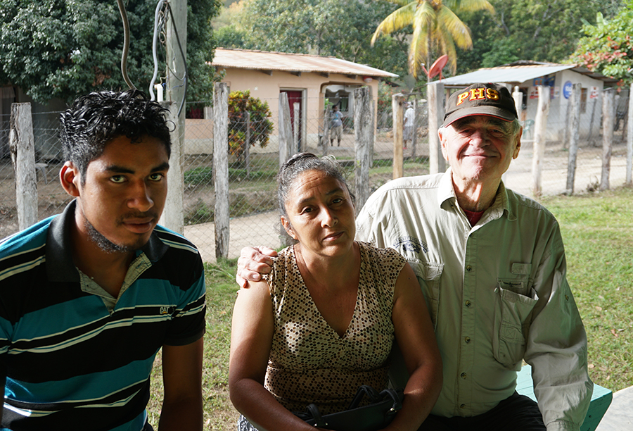 Dean Seibert, a doctor from Vermont, sits with Narcissa Vieda and her son, who live in the nearby village of Los Planes. Credit: Georgina Gustin/InsideClimate News