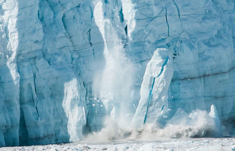 A tidewater glacier calving in Alaska. Credit: David Levine