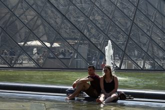 With temperatures in Paris reaching 104 on June 26, tourists used the fountains outside the Louvre Museum to try to cool off. Credit: Dominique Faget/AFP/Getty Images