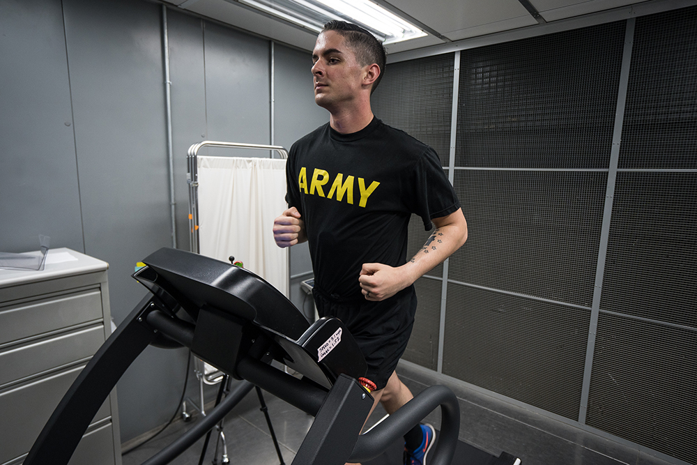 A volunteer runs with a chest sensor that measures his core temperature in an environmental chamber that military medical experts use to simulate extreme hot and cold temperatures. Credit: Brock Stoneham/NBC News