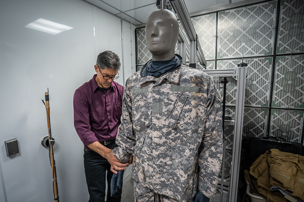 Researcher Julio Gonzalez prepares a sweating mannequin for a heat test at the U.S. Army Research Institute of Environmental Medicine in Massachusetts. Credit: Brock Stoneham/NBC News