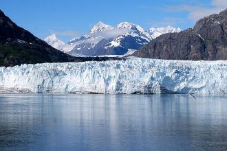 Tidewater glaciers like those seen by millions of tourists in Alaska's Glacier Bay terminate at the ocean, where warming ocean water can expedite melting. Credit: Eric E. Castro/CC-BY-3.0