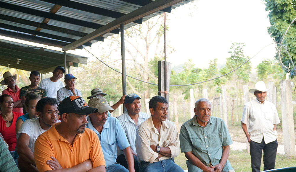 At a village meeting held to discuss climate change and the ongoing drought, residents listen to a presentation on potential solutions. Dionisio Cabrera (center with tan hat) says the only solution is more rain. Georgina Gustin/InsideClimate News