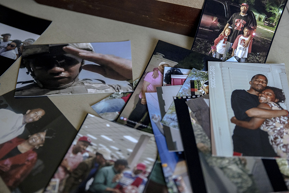 Photos of Sgt. Sylvester Cline on a table in his mother's home. Credit: NBC