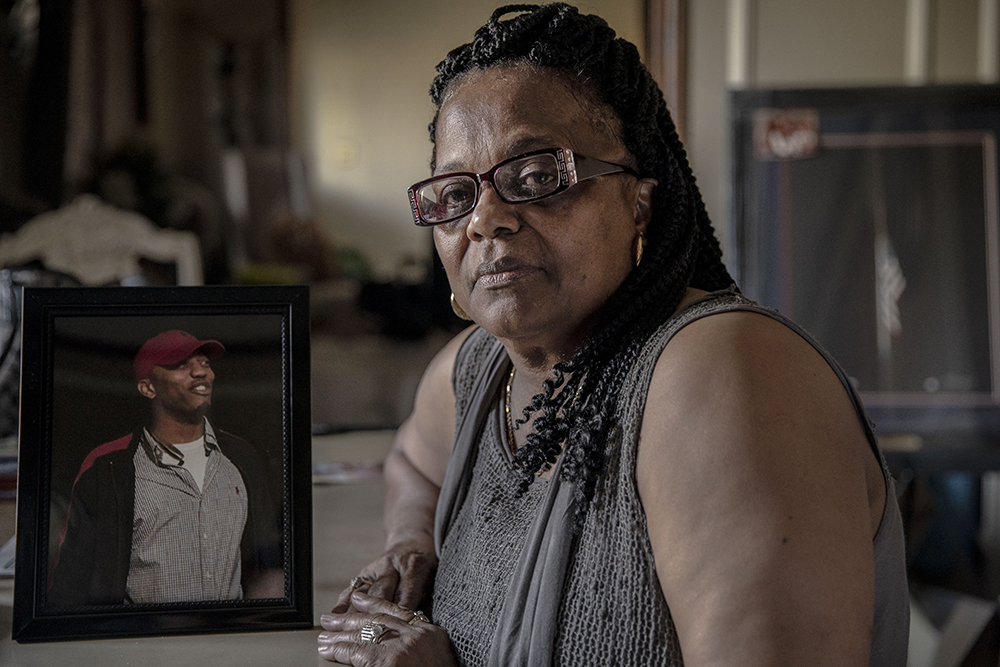 Shirley Cline with a photo of her son, Sgt. Sylvester Cline, an Iraq combat veteran who died in June 2016 during routine training exercises. Credit: Andrea Morales for NBC News