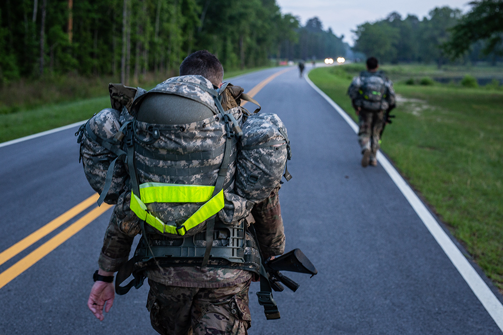 The military has projects underway to better monitor troops' health in the heat. A soldier at Fort Benning participates in a 12-mile march while wearing sensors to measure his core temperature and heart rate. Credit: Brock Stoneham/NBC News