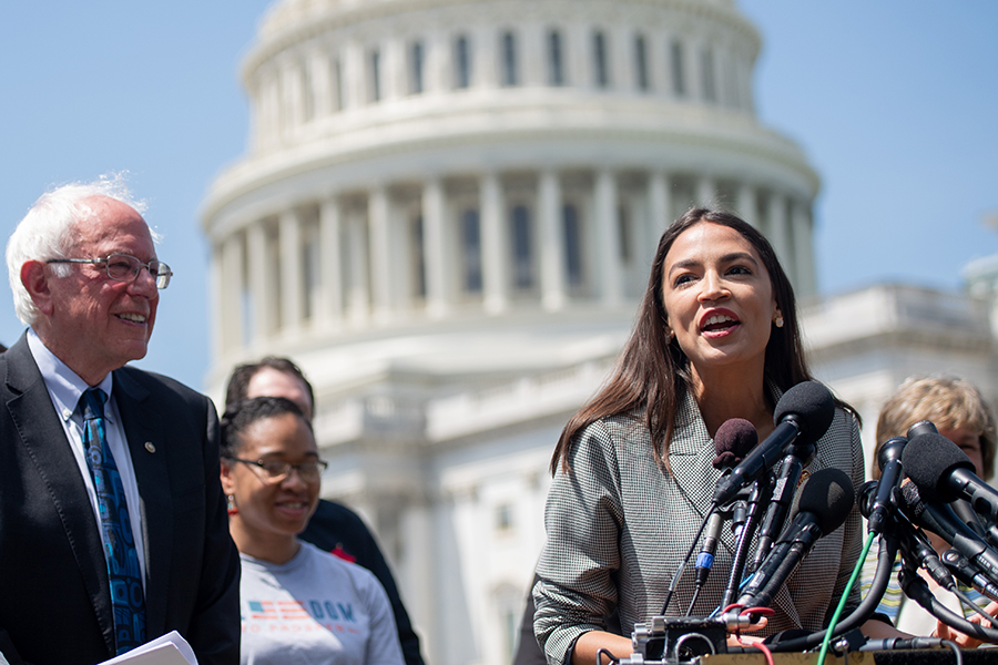 U.S. Rep. Alexandria Ocasio-Cortez and Sen. Bernie Sanders, shown here at a news conference in June, introduced a resolution on July 9, 2019, along with Rep. Earl Blumenauer, calling on Congress to declare a climate emergency. Credit: Saul Loeb/Getty