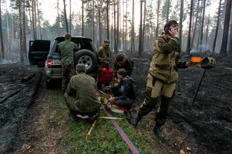 Volunteers fought a wildfire near a summer camp for children in Siberia in late May. Credit: Kirill ShipitsinTASS via Getty Images