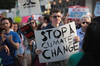 People in Chicago protesting after President Trump announced in 2017 that he would pull the U.S. out of the Paris climate agreement. Credit: Scott Olson/Getty Images