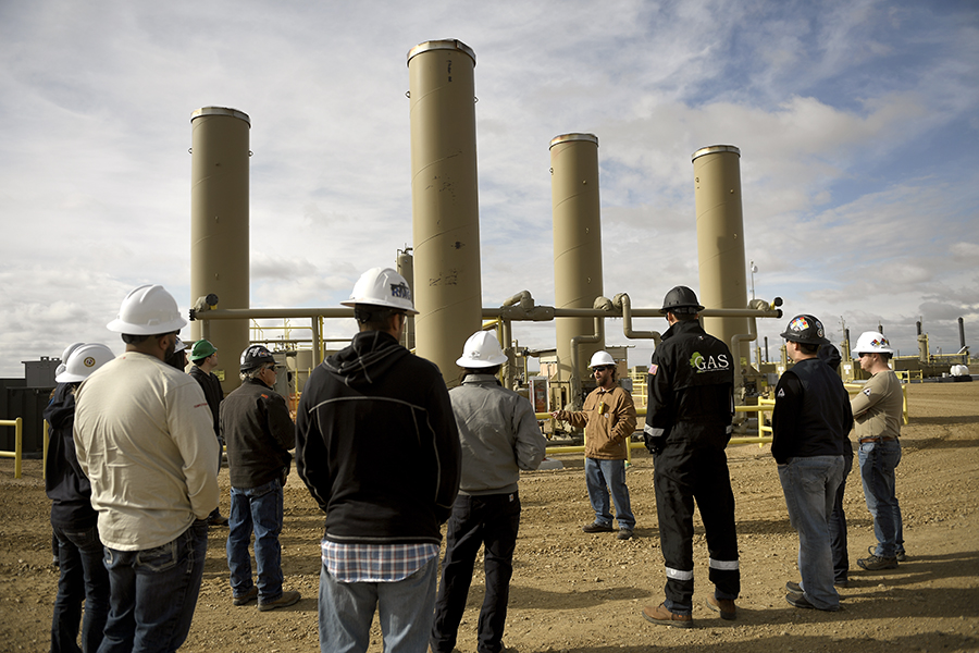 A Colorado Department of Public Health and Environment oil and gas inspector discusses inspection practices in April 2019. Credit: Joe Amon/MediaNews Group/Denver Post via Getty Images.