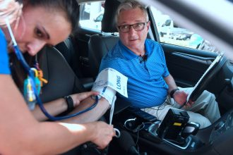 A medical team in Orange, California, with a doctor as the test subject, tests the impact of rising heat inside a car on the human body. Credit: Frederic J. Brown/AFP/Getty Images