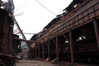 An iron and steel mill sits idle in China after it was ordered to shut down for polluting a river. Credit: Stringer/AFP/Getty Images