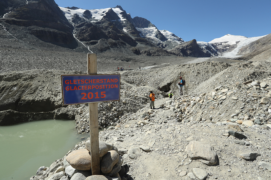 A sign marks the location of Austria's rapidly shrinking Pasterze Glacier in 2015. Credit: Sean Gallup/Getty Images