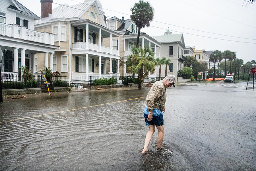 As Hurricane Dorian's rain bands raked the U.S. coast, Bill Olesner cleaned debris from storm drains along a flooded street in Charleston, South Carolina, on Sept. 5, 2019. Credit: Sean Rayford/Getty Images