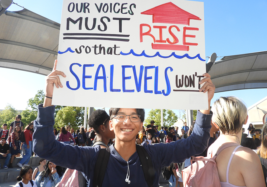 Shane Fejeran, a 17-year-old senior at Eastlake High School in Chula Vista, California, carried a sign highlighting one of the big climate change concerns for coastal communities: sea level rise. Credit: David Hasemyer/InsideClimate News