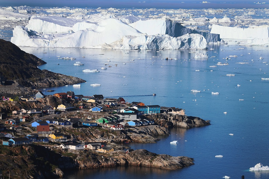 Rising global temperatures that are melting Greenland's ice at a faster pace have also altered the ways in which the local populace farm, fish, hunt and even travel across land. Credit: Joe Raedle/Getty Images