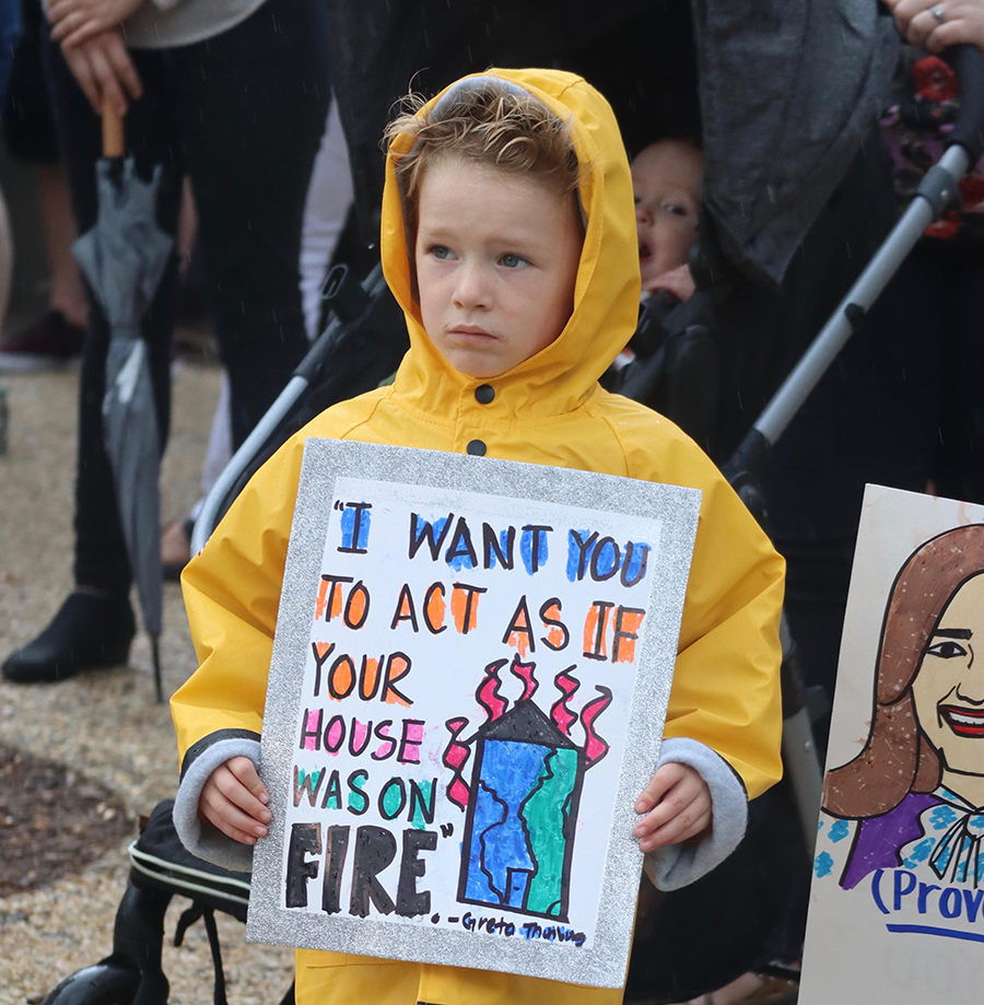 Four-year-old Logan joined a rainy Louisville rally with his mother, Ruth Dowling. Credit: James Bruggers/InsideClimate News