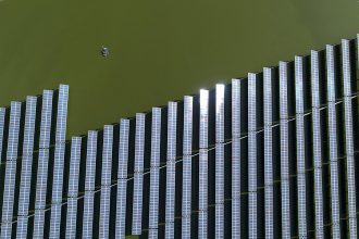 A solar farm built over water in China. Credit: Stringer/AFP/Getty Images