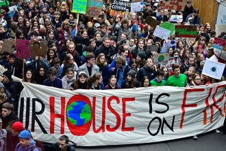 Greta Thunberg (center) at a climate protest in Berlin in March, 2019. Credit: Tobias Schwarz/AFP/Getty Images
