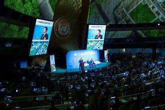 French President Emmanuel Macron addresses the UN Climate Summit. Credit: Johannes Eisele/AFP/Getty Images