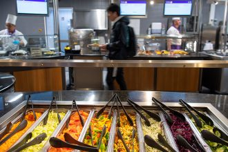 A student walks through a vegan cafeteria on a German college campus. Credit: Monika Skolimowska/picture alliance via Getty Images