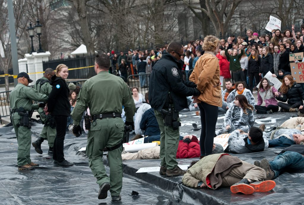 Protestors are arrested demonstrating against the proposed Keystone XL pipeline in front of the White House in 2014