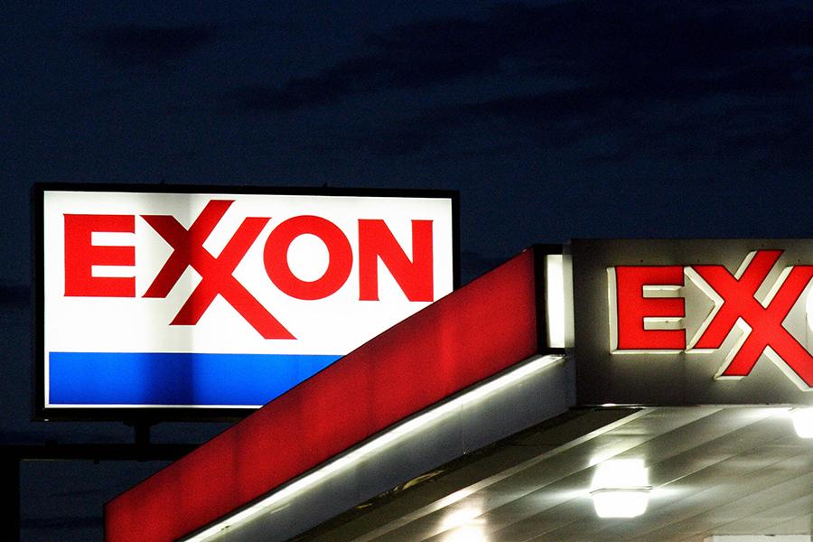 Exxon signs. Credit: Karen Bleier/AFP/Getty Images